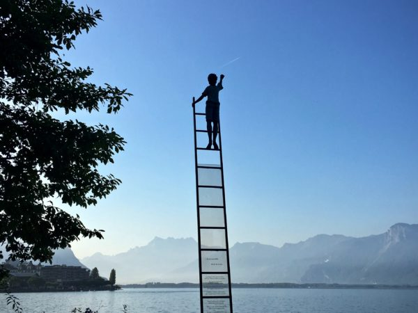 A boy on a ladder to the sky